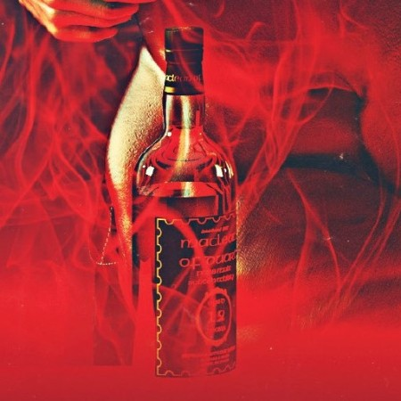 Bottle of whiskey sitting in flames